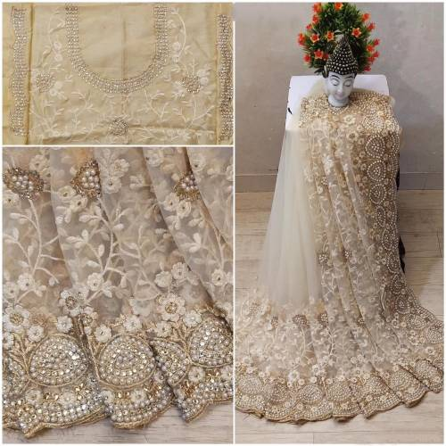 Admiring Cream Soft Net Embroidered Pearl Work Fancy Saree Design
